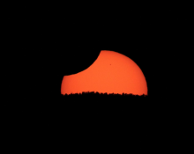 The Sun setting during the partial phase of an annular eclipse. (Don Hladiuk)